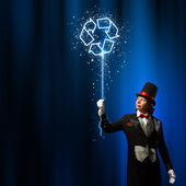 Magician in hat — Stock Photo