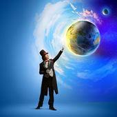 Magician with globe — Stock Photo