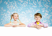 Kids with banner — Stock Photo
