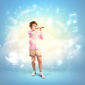 Boy with flute — Stock Photo