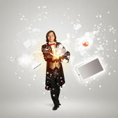 Magician and computer devices — Stock Photo