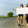 Two girls with banner — Stock Photo