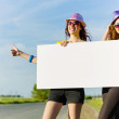 Two girls with banner — Stock Photo #41817225