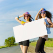 Two girls with banner — Stock Photo #41818367