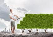 Woman cutting lawn — Stock Photo