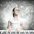 Stock Photo: School girl with piano