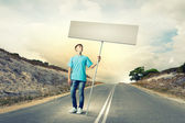 Teenager with banner — Stockfoto