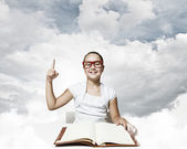 Girl reading book — Stock Photo