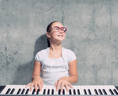 School girl with piano — Stock Photo