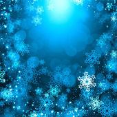 Snöflingor på blå — Stockfoto