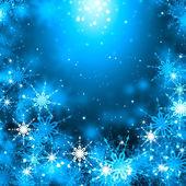 Schneeflocken auf blau — Stockfoto