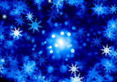 Snowflakes on blue — Stockfoto