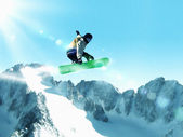 Snowboarding in mountains — Stock Photo