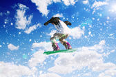 Snowboardåkare i hopp — Stockfoto