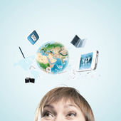 Half of face of businesswoman with business items above head — Stockfoto