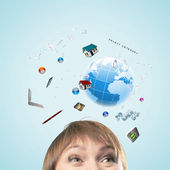 Half of face of businesswoman with business items above head — Stock Photo