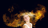 Blond in fire — Stock Photo