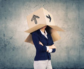 Woman with box on head — Stock Photo