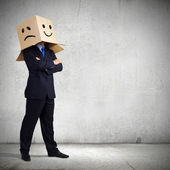 Businessman with box on head — 图库照片