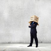 Businessman with box on head — Stock Photo