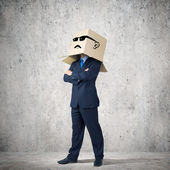 Businessman with box on head — Foto Stock