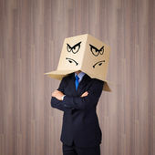 Businessman with box on head — Stok fotoğraf