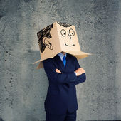 Businessman with box on head — Foto de Stock