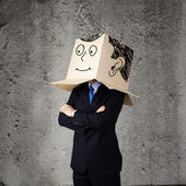 Businessman with box on head — Zdjęcie stockowe