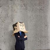 Uomo d'affari con la scatola sulla testa — Foto Stock