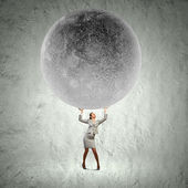 Businesswoman lifting moon — Stock Photo