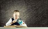 Schoolgirl examining opened book — Zdjęcie stockowe