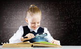 Girl in world of knowledge — Stock Photo