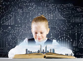 Girl on lesson with open book — Stockfoto