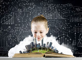 Girl on lesson with open book — Stock Photo