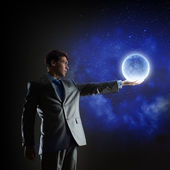 Man with moon — Stock Photo