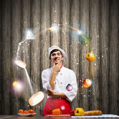 Cook at kitchen — Stock Photo