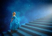 Girl in blue dress — Stock Photo