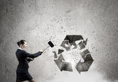 Businesswoman crashing stone recycle symbol — Foto Stock