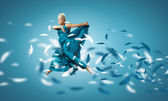 Woman in blue dress jumping — Stock Photo