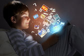 Kid with tablet pc — Stock Photo