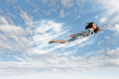 Flying businesswoman — Foto Stock