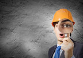 Architect looking in magnifying glass — Stock Photo