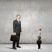 Businesspeople of various sizes — Stock Photo