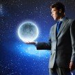 Businessman holding moon planet — Stock Photo #51744403