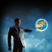 Businessman holding Earth planet in hand — Stock Photo