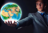 Businessman holding Earth planet in hand — Foto Stock