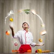 Man juggling with ingredients — Stock Photo