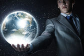Businessman holding Earth planet — Stock Photo