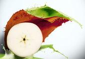 Juicy fruits against splashes — Stock Photo