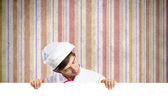 Cook holding blank banner — Stockfoto